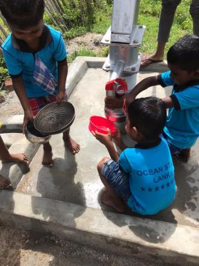 Children at the new well