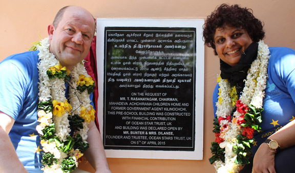 John and Dilanee and the new pre-school building