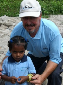 Danny with an Ocean Stars pupil - opening of new class in Karaveddy, Sri Lanka