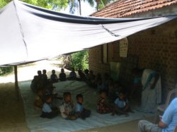 Children's classroom under tarpaulin - Karaveddy, Sri Lanka