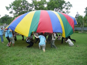 Playing with the parachute at Graces Childrens Home
